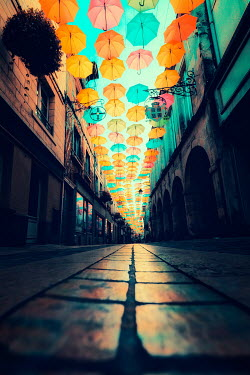 David Keochkerian Colorful umbrellas above city footpath