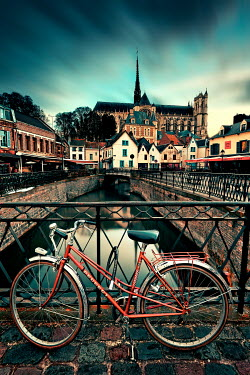 David Keochkerian Bicycle locked to railing on bridge by canal