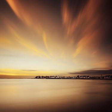 David Keochkerian Sunset sky above coastal town