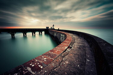 David Keochkerian Walkway to lighthouse at sunset