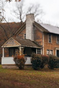 Lisa Bonowicz Weathered house and bushes