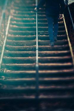 Lisa Bonowicz Man walking up stairs