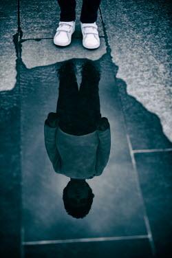Mohamad Itani Reflection of boy in puddle