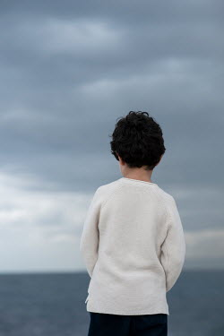 Mohamad Itani Boy by sea from behind