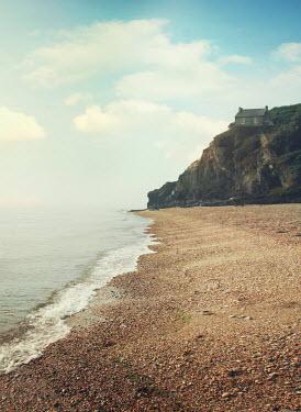 Mark Owen House on cliff above beach