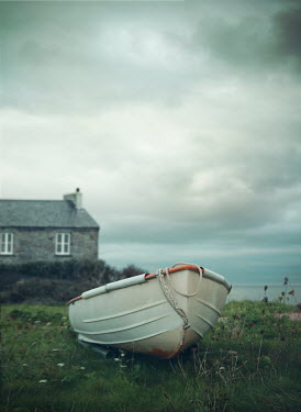 Mark Owen Boat and cottage by coast