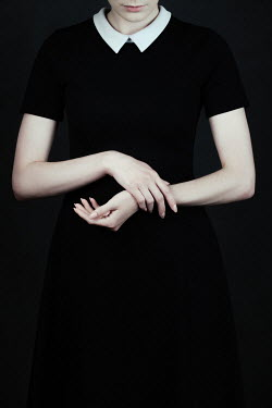 Magdalena Russocka woman in black dress with white collar inside