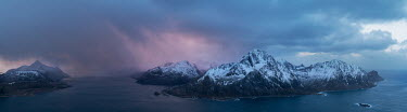 Ollie Taylor Snowy mountains and sea at sunset