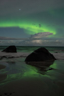 Ollie Taylor Northern lights above beach