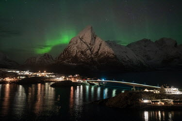 Ollie Taylor Northern lights above mountains in Hamnoy, Lofoten Islands, Norway