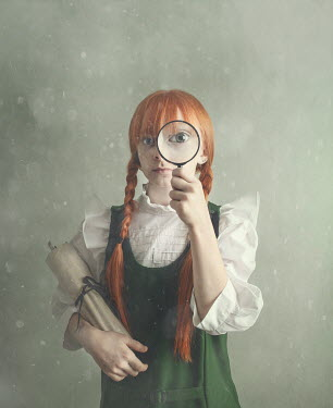 Anna Buczek Girl with red hair in pigtails using magnifying glass