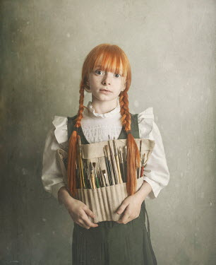 Anna Buczek Girl with red hair in pigtails holding paint brushes in pouch