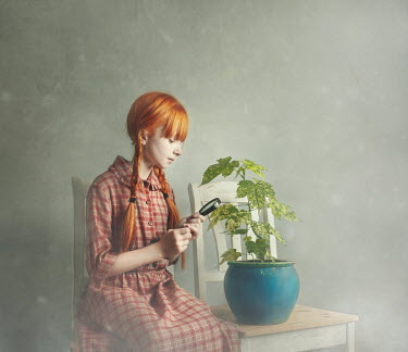 Anna Buczek Girl with magnifying glass and potted plant