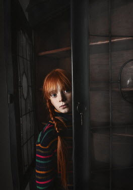 Anna Buczek Girl with red hair in wardrobe