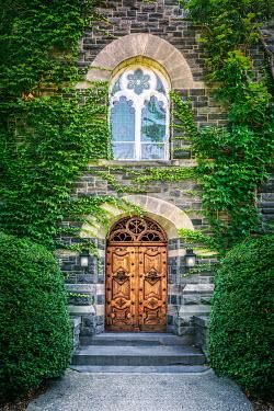 Evelina Kremsdorf Ivy on mansion with ornate wooden door