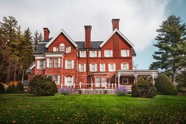 Evelina Kremsdorf Brick mansion and trees