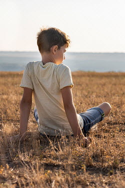 Galya Ivanova Boy sitting in field under sunshine