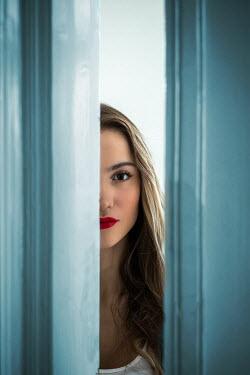 Ildiko Neer WOMAN PEERING BEHIND DOORWAY INSIDE Women