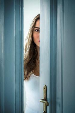 Ildiko Neer Half face of modern woman behind doors