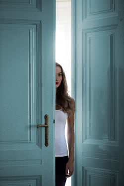 Ildiko Neer Half part of modern woman behind doors