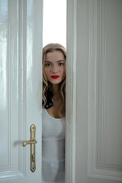 Ildiko Neer Modern woman staring behind opened doors