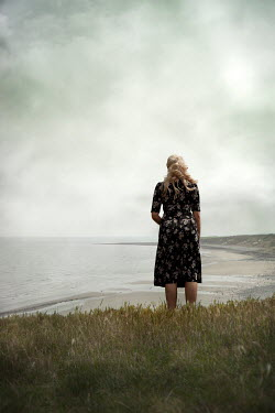 Miguel Sobreira Forties Blonde Woman Standing on Hilltop Overlooking Bay