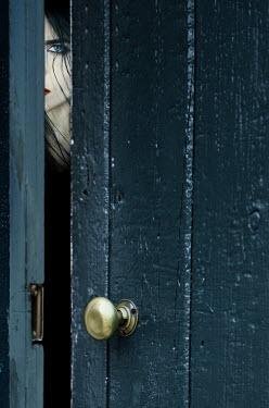 Magdalena Russocka woman peeking through ajar door