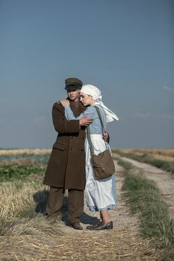 Magdalena Russocka wartime soldier and nurse embracing in field Couples