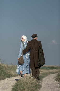 Magdalena Russocka wartime soldier and nurse walking in field