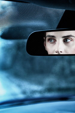 Magdalena Russocka woman reflected in car rearview mirror