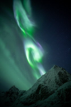 Ollie Taylor Northern lights above snowy mountain
