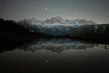 Ollie Taylor Mountains reflected in lake at night