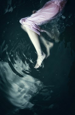 Natasza Fiedotjew legs of woman in night gown floating in water