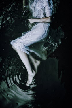 Natasza Fiedotjew woman in night gown floating in water