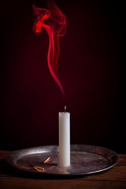 Magdalena Wasiczek SMOULDERING CANDLE ON SILVER PLATE WITH RED SMOKE Miscellaneous Objects