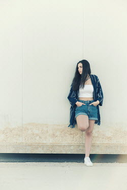 Mohamad Itani GIRL WITH LONG DARK HAIR IN SHORTS LEANING ON WALL Women