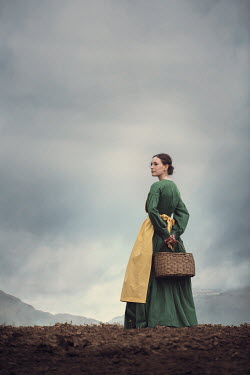 Magdalena Russocka historical woman carrying basket in field with mountains