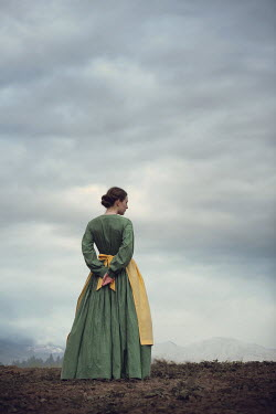 Magdalena Russocka historical woman in field with mountains
