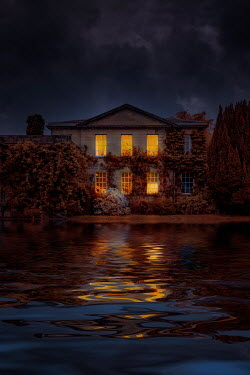 Nic Skerten LIGHTS IN WINDOWS OF MANSION BY LAKE AT NIGHT Houses