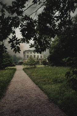 Nic Skerten MANSION WITH TREES AND PATHWAY AT DUSK Houses