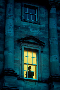 Nic Skerten SILHOUETTED WOMAN IN WINDOW OF GRAND HOUSE Women