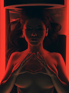 Rafael Sanchez Garcia WOMAN LYING IN SCANNER WITH RED LIGHT Women