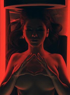 Rafael Sanchez Garcia WOMAN LYING IN SCANNER WITH RED LIGHT Women