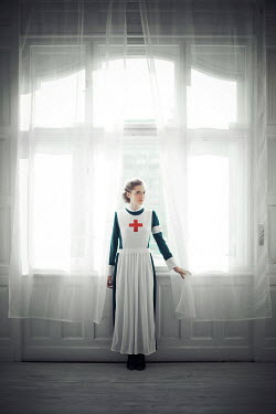 Ildiko Neer Wartime nurse standing by window Women