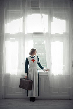 Ildiko Neer Wartime nurse sunbathing at window