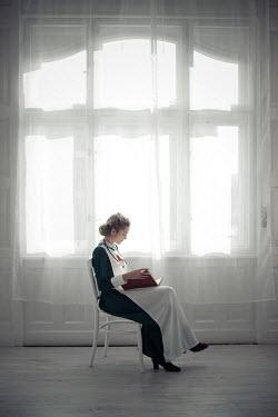 Ildiko Neer Wartime nurse sitting and reading by window