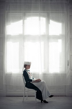 Ildiko Neer Wartime nurse sitting by window