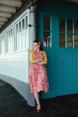 Matilda Delves HAPPY RETRO WOMAN WAITING ON STATION PLATFORM Women