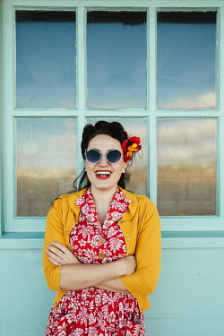 Matilda Delves HAPPY RETRO WOMAN OUTSIDE WINDOW OF BUILDING Women