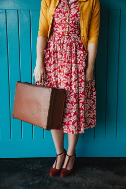 Matilda Delves RETRO WOMAN IN RED DRESS CARRYING SUITCASE Women